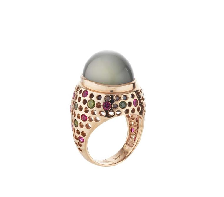 Holts London Vivienne ring with a central moonstone set in a rose gold band studded with natural pink spinels and green diamonds (£3,950).