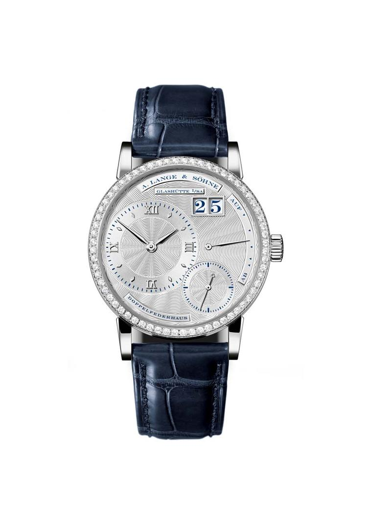 The Little Lange 1 for women in white gold, with a solid silver dial, sparkles with a diamond bezel set with 64 brilliant-cut diamonds.