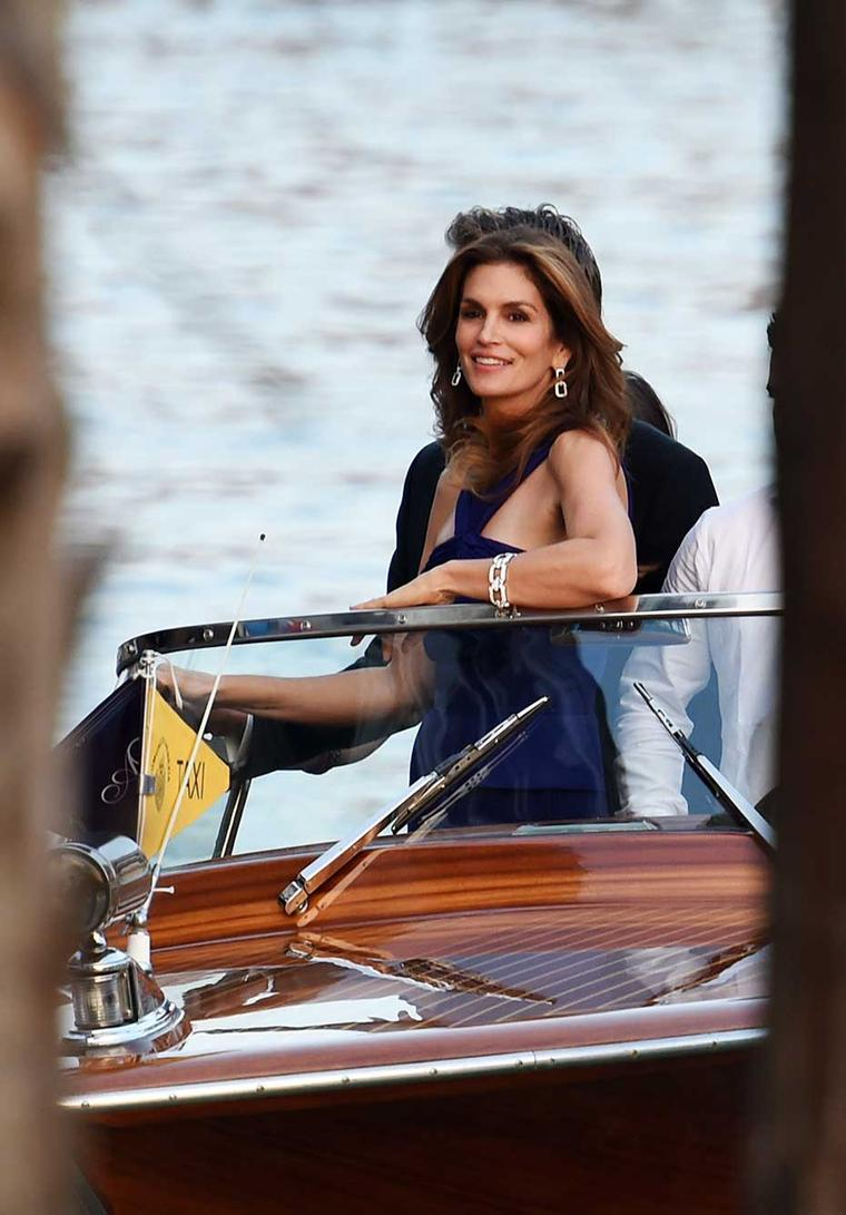 Cindy Crawford wears Harry Winston diamonds to the wedding of George Clooney