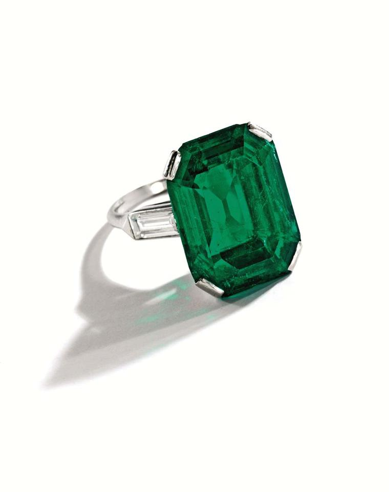 An emerald and diamond ring.