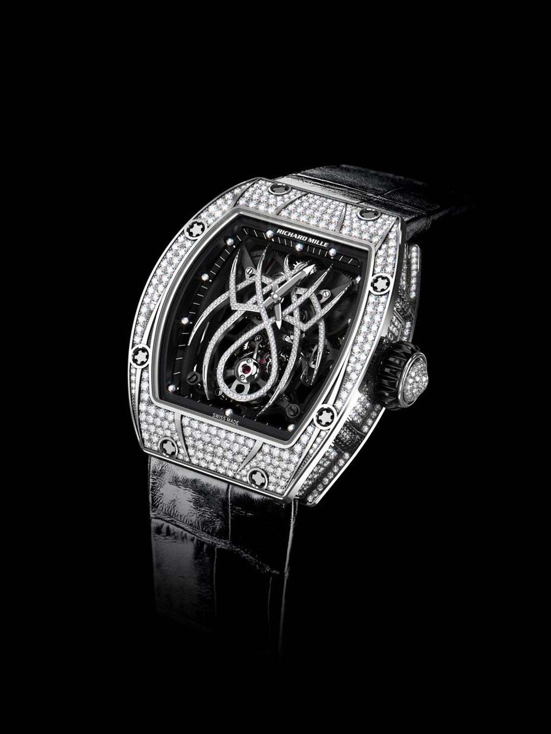 Designed in collaboration with Natalie Portman, the tourbillon movement in the Richard Mille RM 19-01 watch features a diamond-set spider that spreads his tapered legs across the dial while his abdomen holds the tourbillon cage.