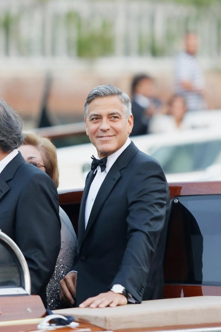 George Clooney looks every inch a man in love as he makes his way by speed boat to his Venice wedding while wearing the The Omega De Ville Trésor watch in white gold.