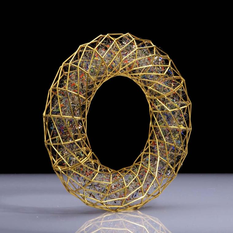 Giovanni Corvaja gold cage bracelet packed with thousands of dancing fine wires, each topped with different coloured enamels (£45,000). Image courtesy of Adrian Sassoon, London.