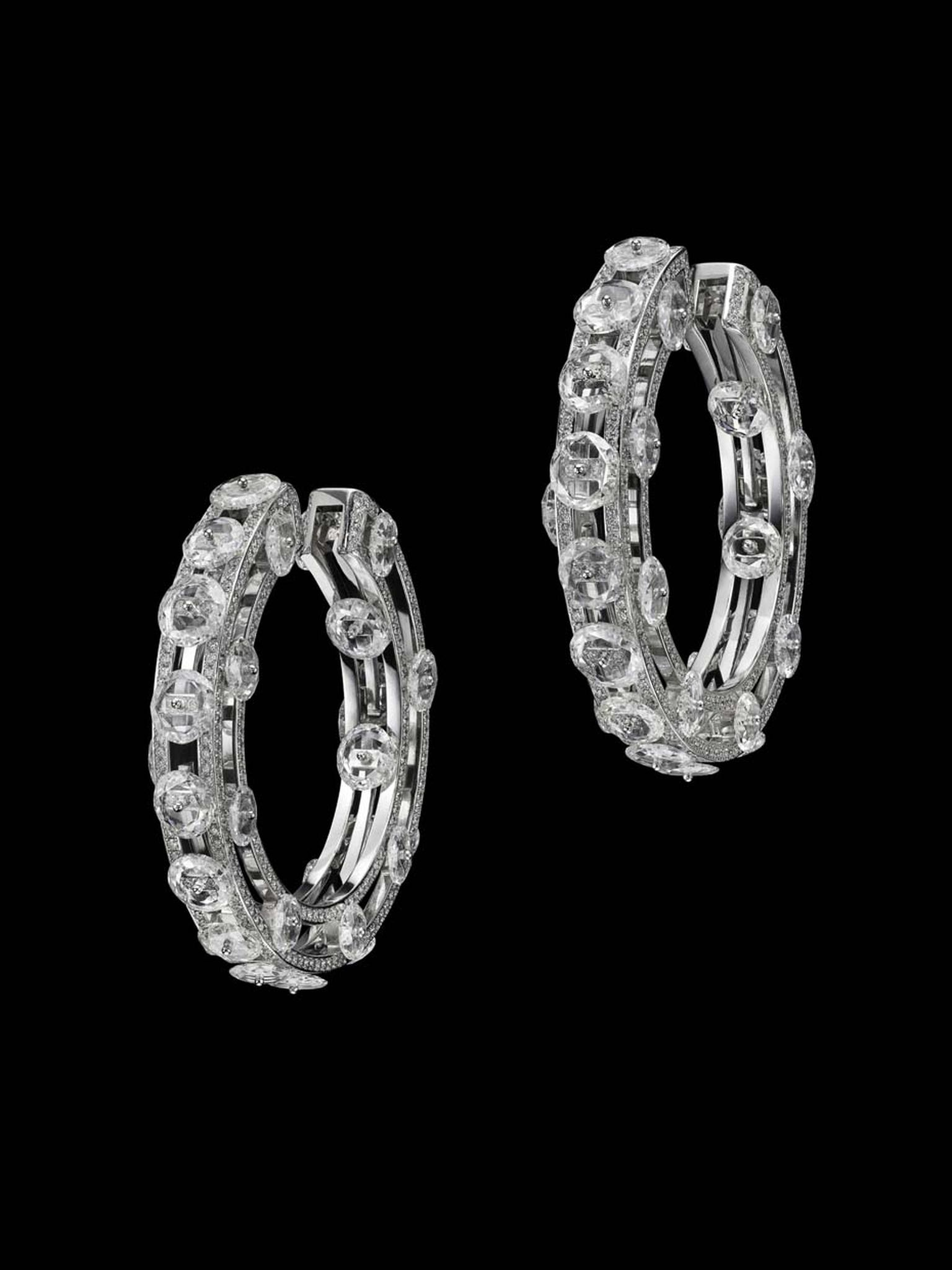 Suzanne Syz Wheel of Brilliance earrings in white gold set with 58 slice diamonds and 1,128 diamonds.