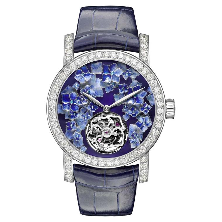 Chaumet limited-edition Hortensia automatic tourbillon watch in white gold, set with diamonds surrounding a dial of hydrangea flowers, sculpted and hand-engraved with Grand Feu enamelling.