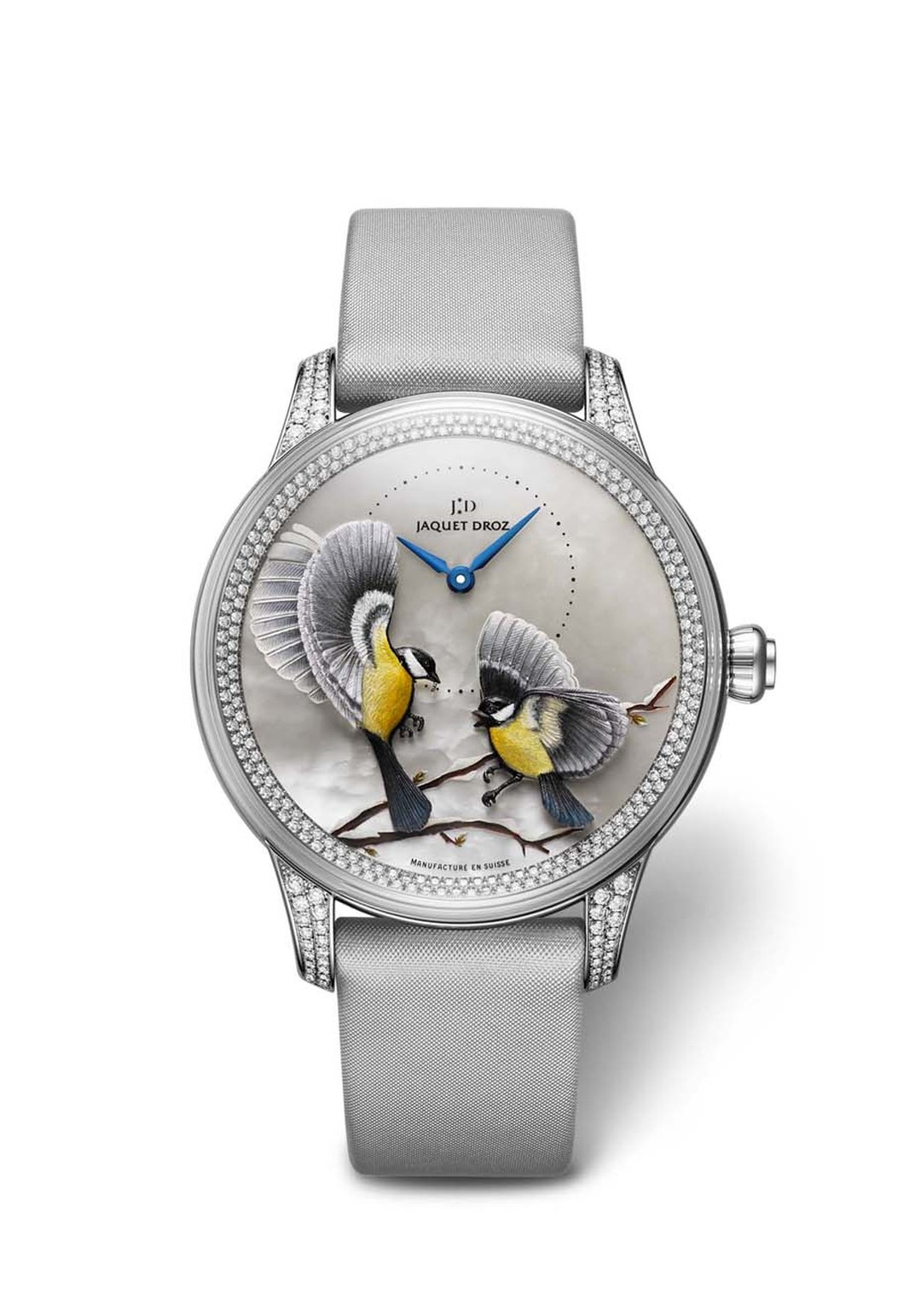 Jaquet Droz' Petite Heure Minute Relief Saisons watch features birds that were sculpted and engraved in gold before being applied to the dial and painted by hand.
