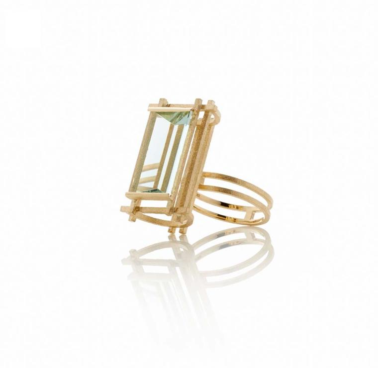 Shimell and Madden's Prism collection Large Aqua Frame ring in textured yellow gold with a  6.63ct mirror-cut aquamarine.