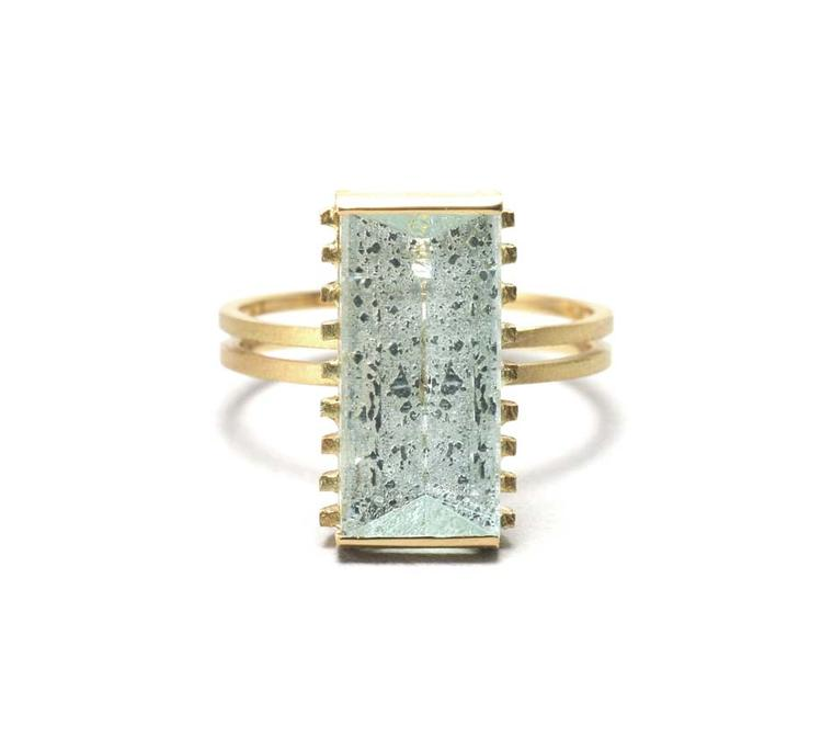 Shimell and Madden's Prism collection Rough Aqua Strut ring in textured gold with a 4.35ct mirror-cut aquamarine.