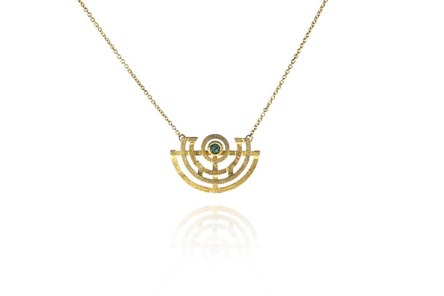 Shimell and Madden's Symmetry collection Symmetry pendant with a Paraiba tourmaline.
