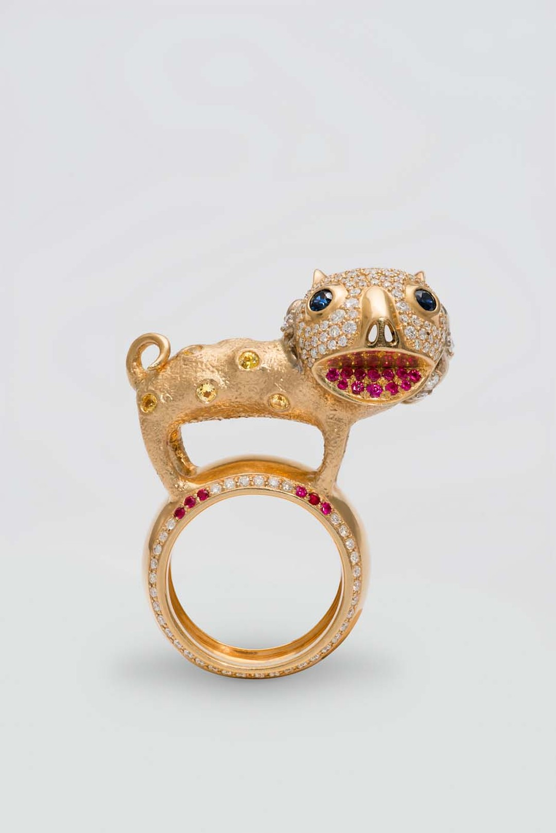 Dashi Namdakov white and yellow gold Lion ring featuring diamonds, rubies and sapphires.