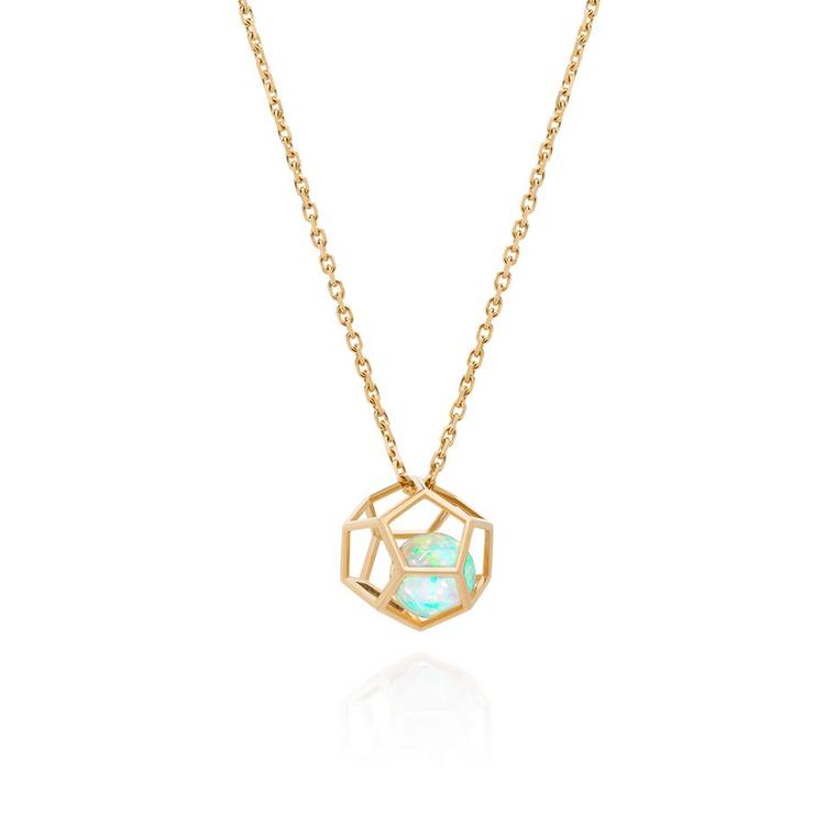 Ornella Iannuzzi's Rock It! necklace, created in collaboration with the Parisian jeweller Capet Joaillier, features an opal suspended inside a geometric golden cage.