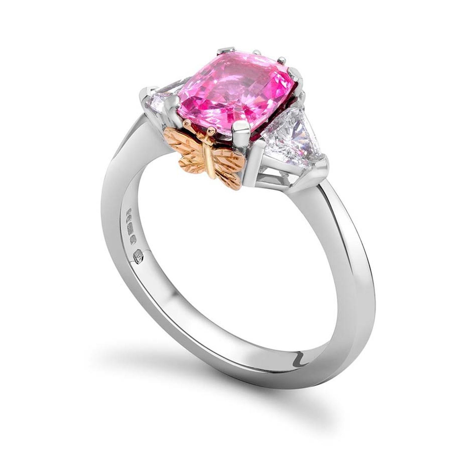 Theo Fennell pink sapphire and diamond Butterfly ring in white gold with a pink gold butterfly perched on the side of the centre stone.