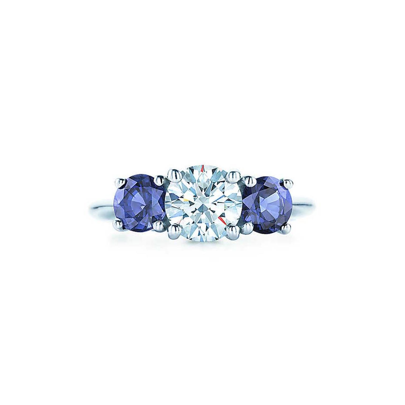 Tiffany & Co. ring featuring a central brilliant-cut diamond flanked by a sapphire on either side.