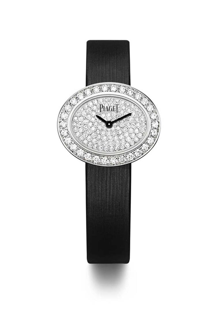Piaget Limelight Diamonds watch in white gold with an oval-shaped case and black lacquer dial, set with 1.00ct diamonds on the bezel and a further 0.60ct on the dial, presented on a black satin strap with an ardillon buckle set with a single diamond.