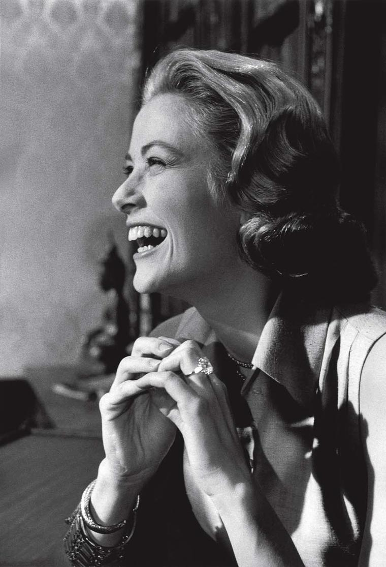 Princess Grace Kelly wearing her 10.47ct Cartier diamond engagement ring, given to her by Prince Rainier III.