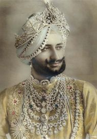Sir Bhupindar Singh, the Maharaja of Patiala, wearing the spectacular bib-style Cartier necklace he commissioned, set with almost 1,000 carats of diamonds.