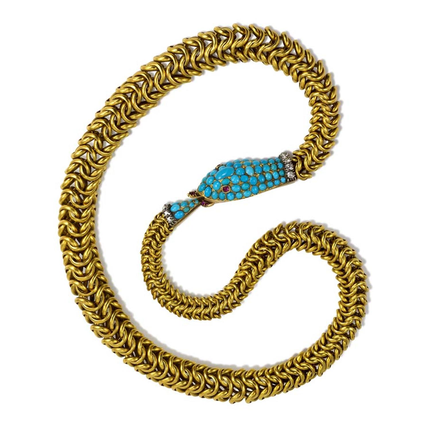 An antique gold box chain in the form of an Ouroboros snake with a pavé turquoise head and tail with diamonds and rubies, circa 1870. Exhibited by Kentshire.