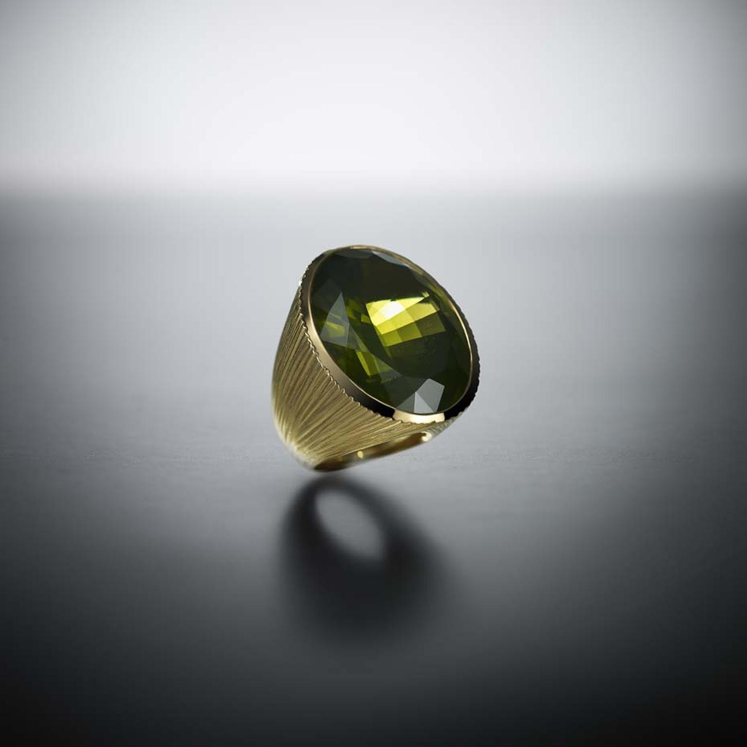 Walid Akkad peridot and textured gold ring.