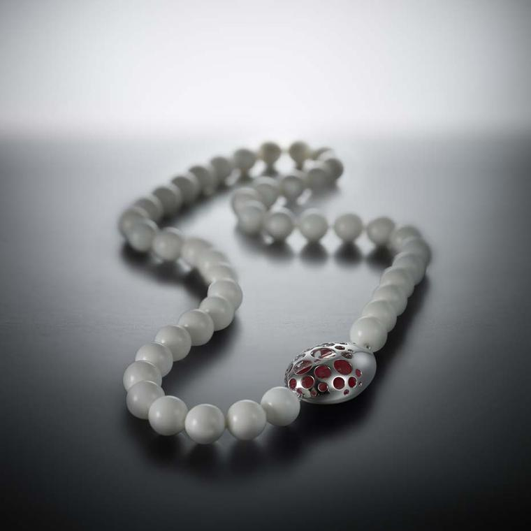 Walid Akkad chalcedony bead necklace with a fuchsia pink enamel clasp set in white gold.