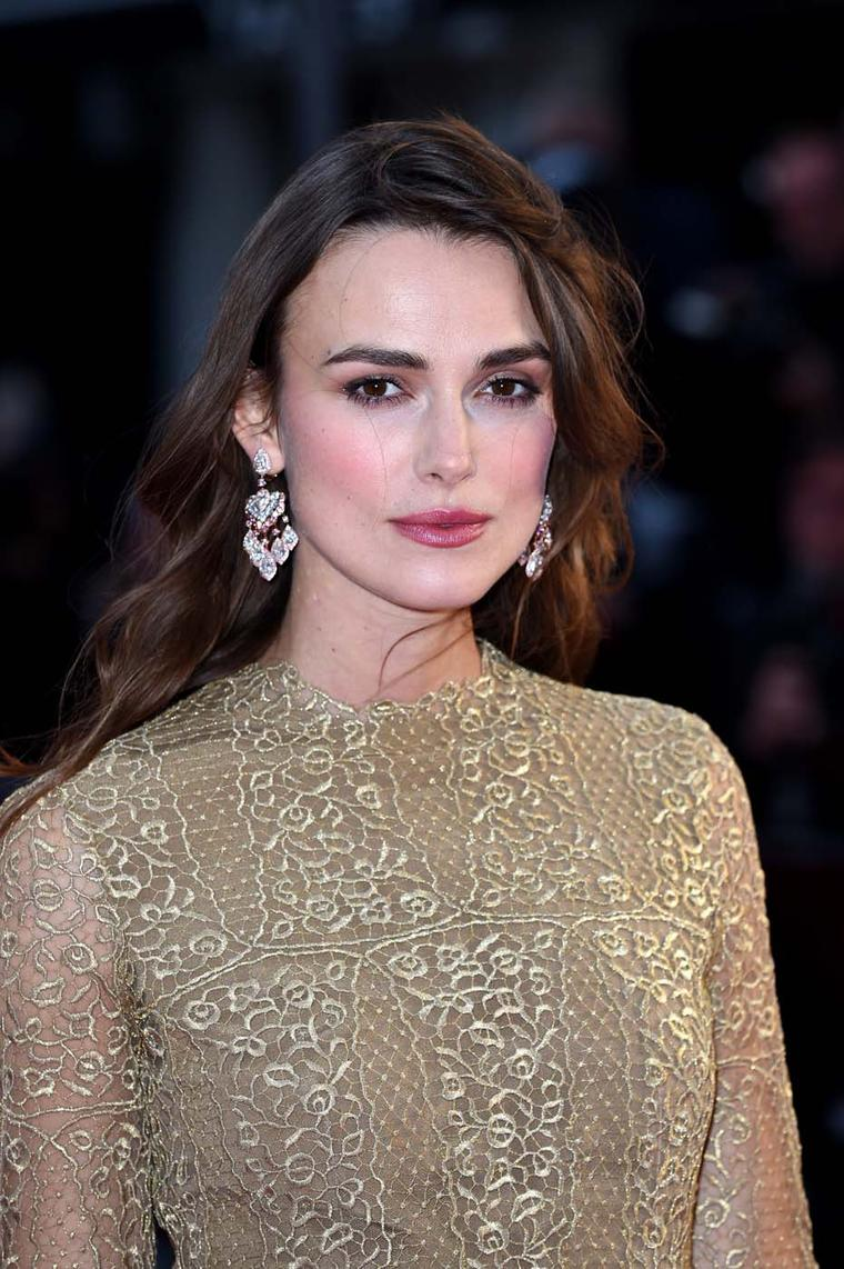 The David Morris pink and white diamond Pagoda earrings perfectly complemented the actress' Valentino Couture gold lace dress as she braved the blustery weather for the opening of the 58th BFI London Film Festival last week.
