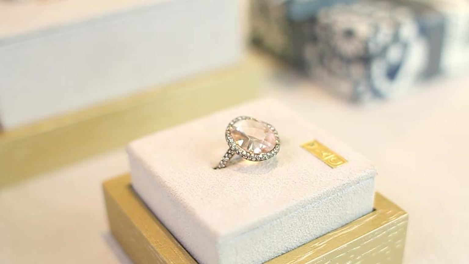 Astley Clarke's Fao collection ring with a centre morganite gemstone surrounded by a pavé of diamonds.