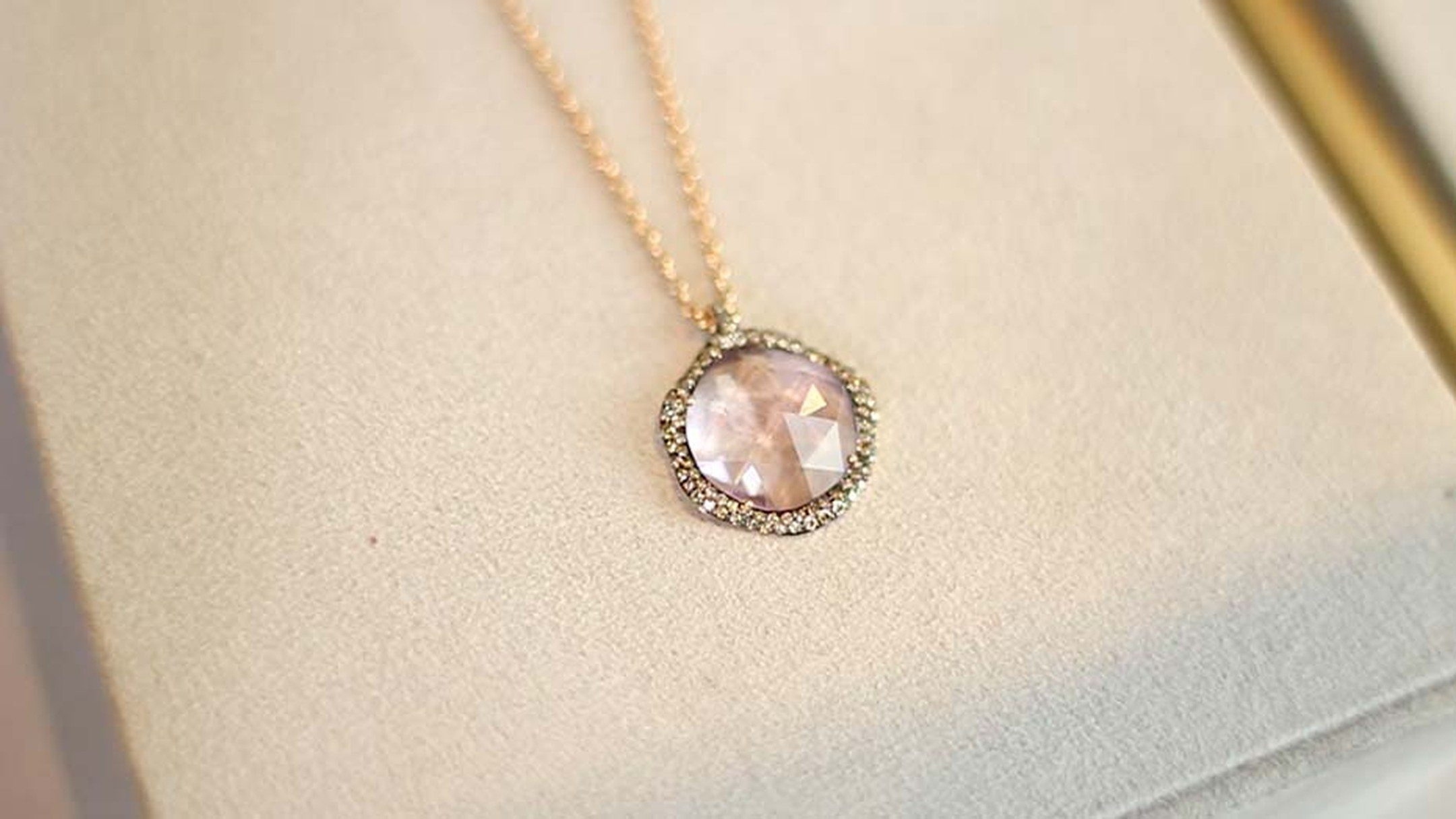 Astley Clarke Fao collection necklace with a morganite encircled by pavé diamonds.
