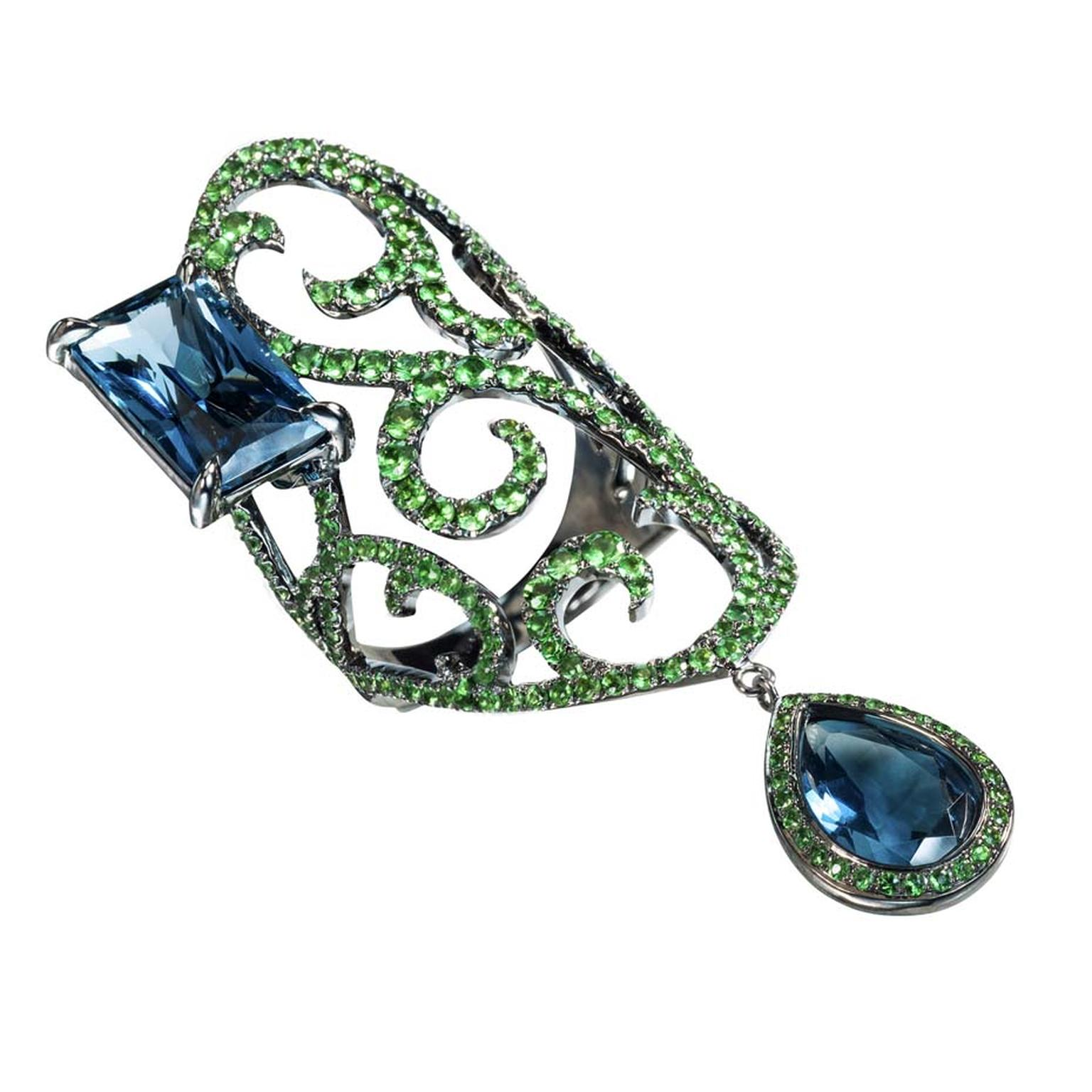 Dionea Orcini white gold arabesque Jaipur ring featuring tsavorites and London blue topaz.