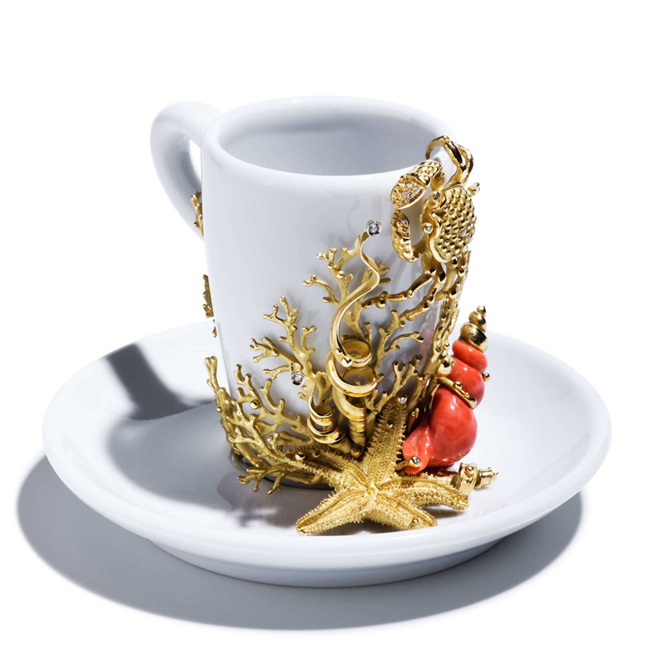 Massimo Izzo coffee cup featuring Mediterranean motifs in gold and coral, from the Jewels of the Sea collection.