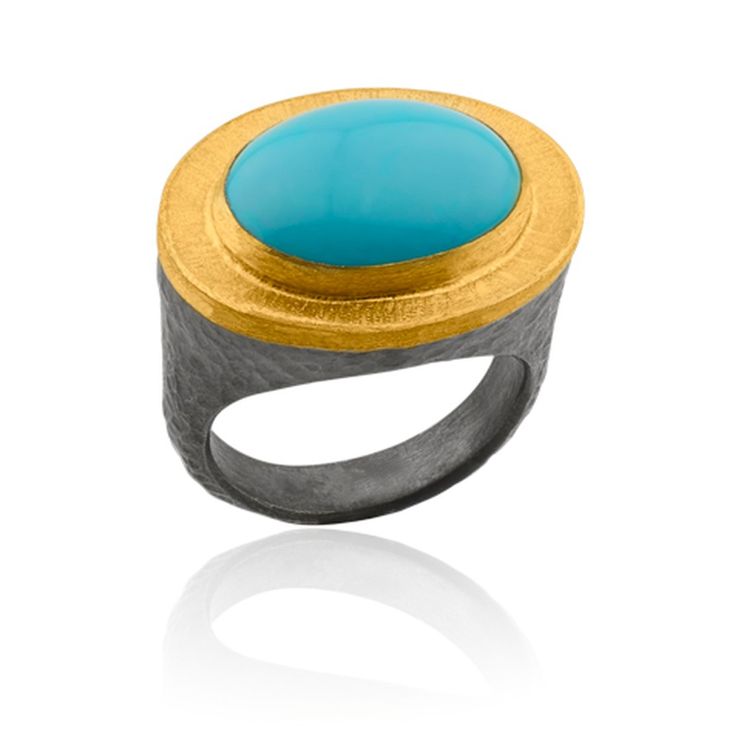 Lika Behar cabochon turquoise ring in a collet setting of yellow gold and silver.