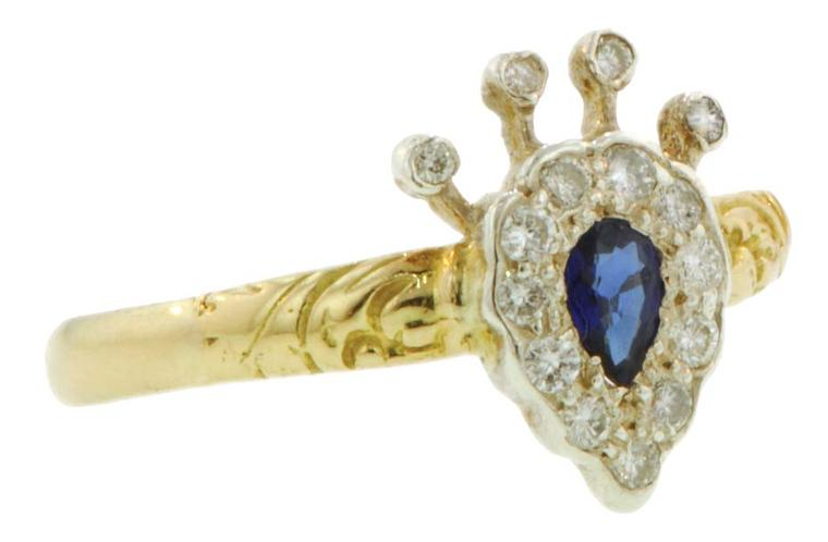 Crown/heart ring featuring a pear-shaped sapphire framed and topped with diamonds. From the private collection of Danielle Miele.