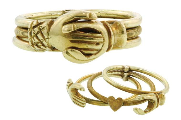 Gold Fede Gimmel ring featuring three movable attached rings that, when closed, shows two hands clasped and when opened displays a heart.