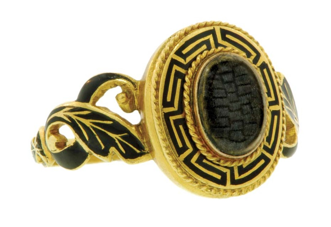 Mourning ring featuring gold, black enamel and hair, circa 1850.