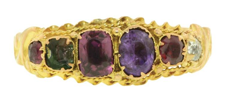 English Regard ring circa 1870 featuring ruby, emerald, garnet, amethyst and diamond stones in a twisted wire frame with scrolled shoulders.