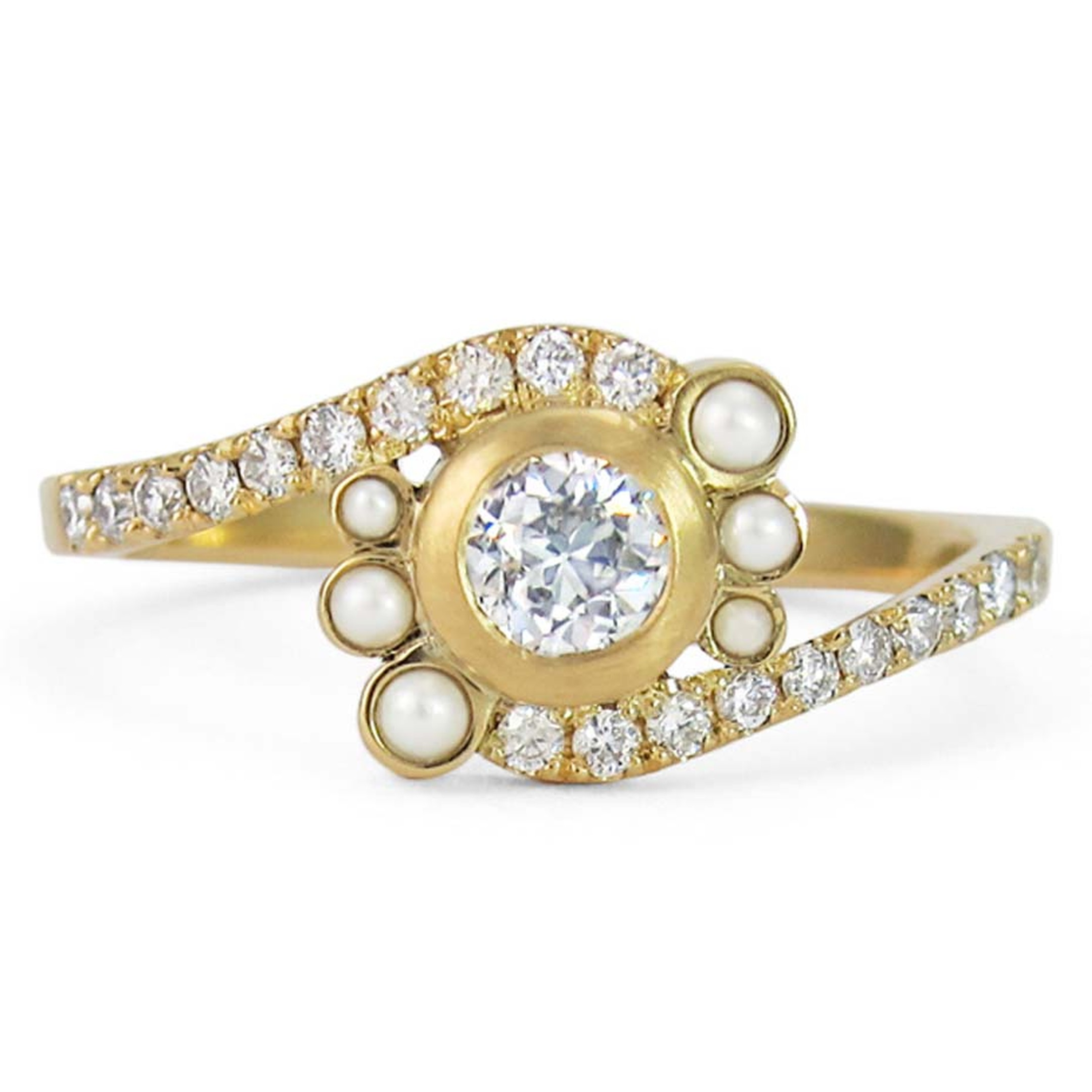 Jessica Poole engagement ring featuring a centre brilliant-cut diamond encircled by 6 pearls and a pavé diamond band.