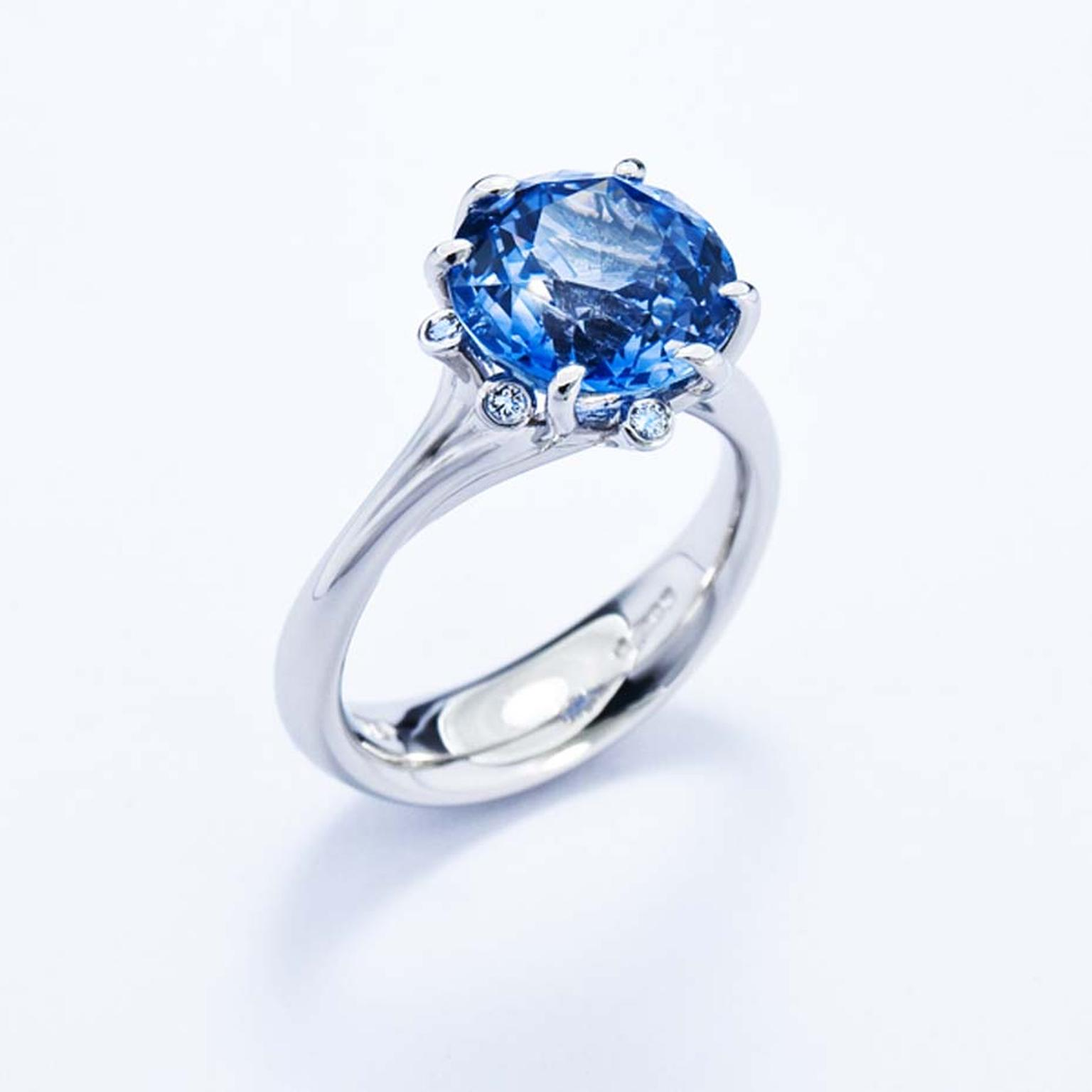 Jon Dibben Meadow ring with a centre sapphire set in platinum.