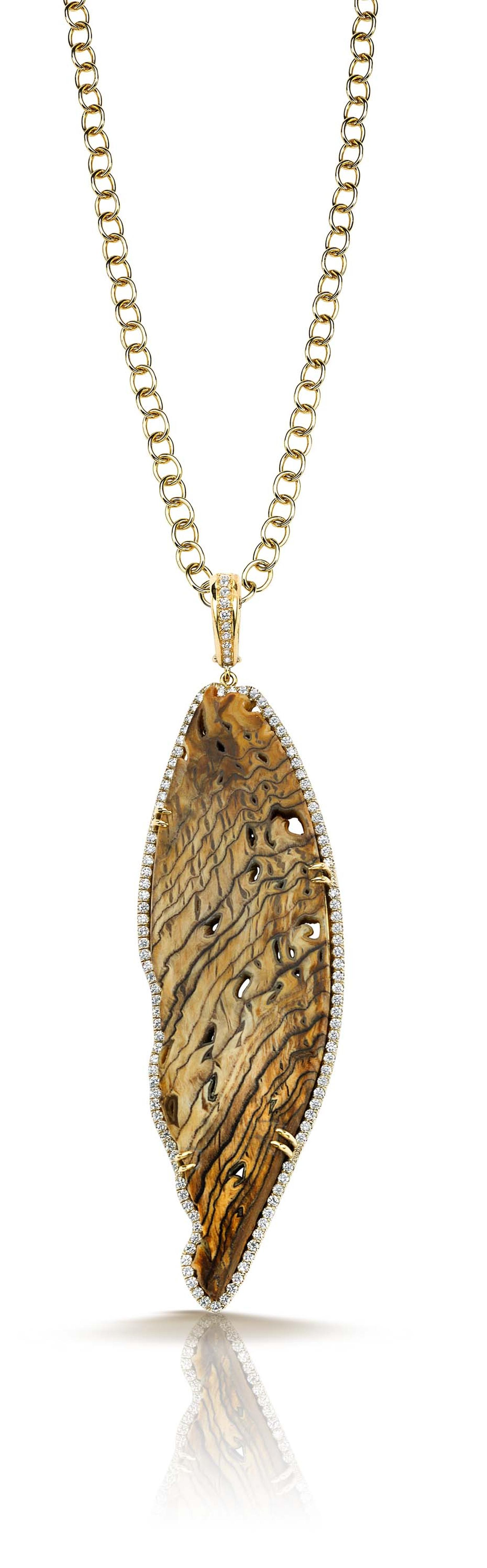 Pamela Huizenga gold pendant with a fossilized Sequoia center stone and a diamond pavé frame ($14,000).