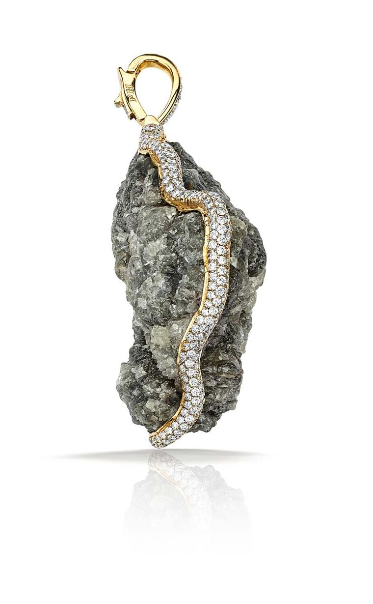 "Pamela Huizenga gold pendant is designed to be worn on either side, it is set in a refined frame of double pavé white diamonds that flow naturally around the stone: ""The delicate pavé contrasts with the roughness of the raw diamond and highlights its natu"