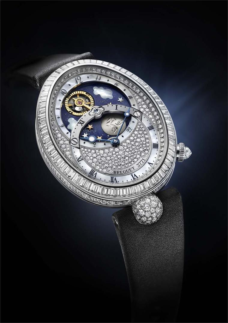 Breguet Reine de Naples Jour/Nuit watch indicates the hours and minutes in the lower dial; the upper dial enacts the daily transit of the Sun represented by the golden tourbillion.