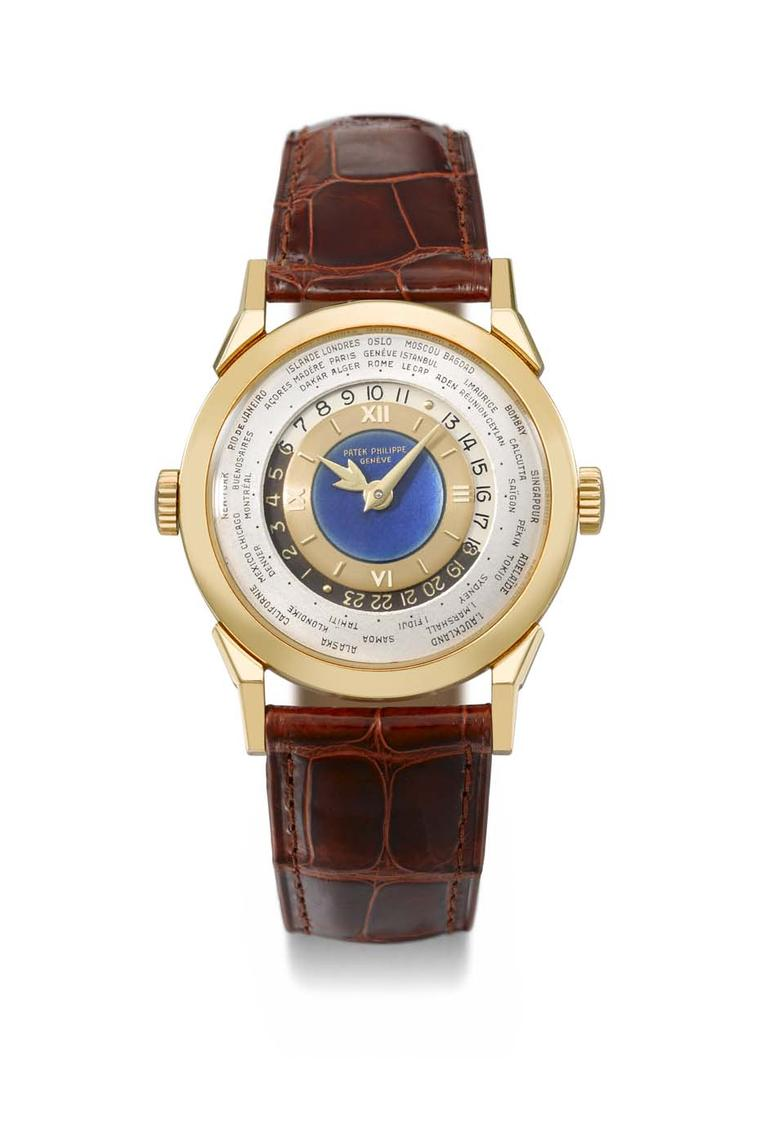 Vintage Patek Philippe Reference 2523 gold world time watch with a blue enamel dial.
