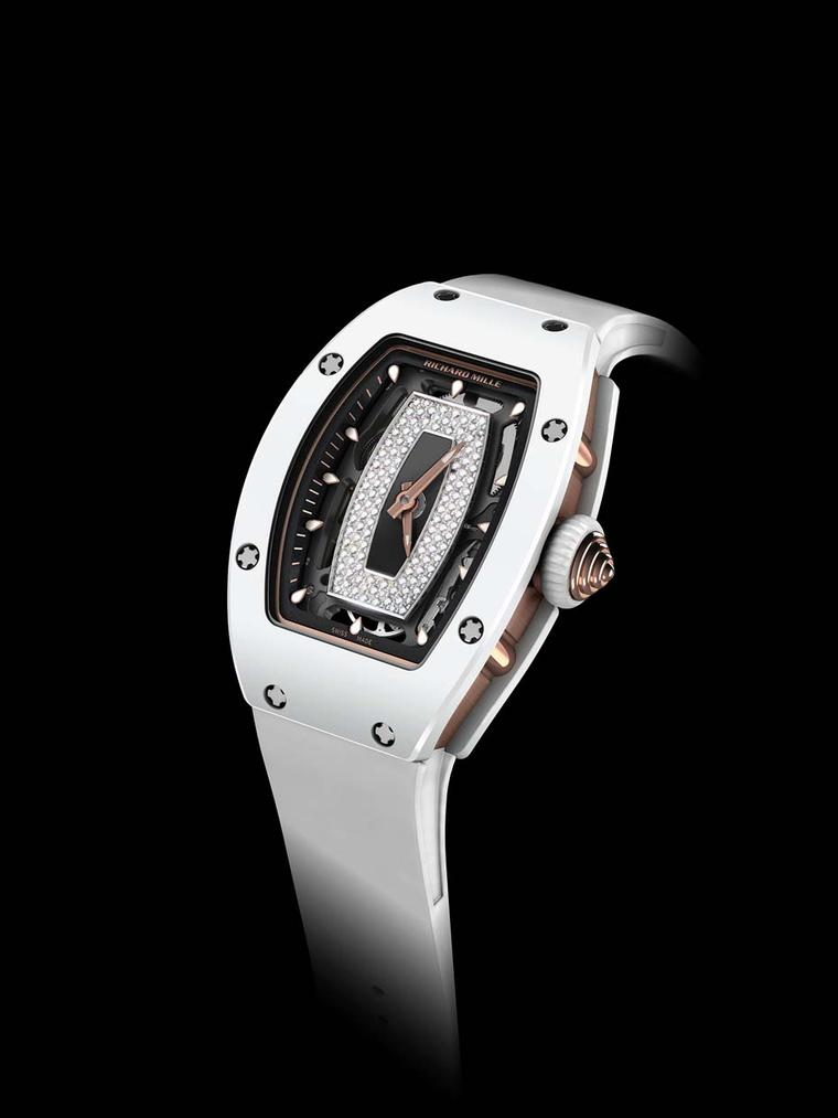 Crafted from white ceramic and red gold, the Richard Mille 07-01 watch features a tonneau-shaped case housing a skeletonised dial that showcases the movement. The decorative pavé diamond inner dial mirrors the shape of the bezel and has central luminescen