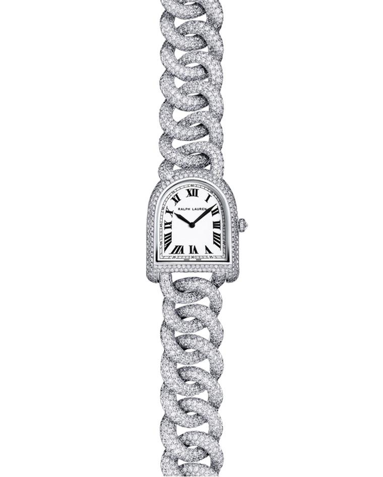 The Ralph Lauren Stirrup Petite watch offers a daintier case measuring just 23.3mm by 27mm and an intertwining link bracelet that wraps elegantly around the wrist. The most opulent model is this Petite Stirrup Link watch in white gold and diamonds. This s
