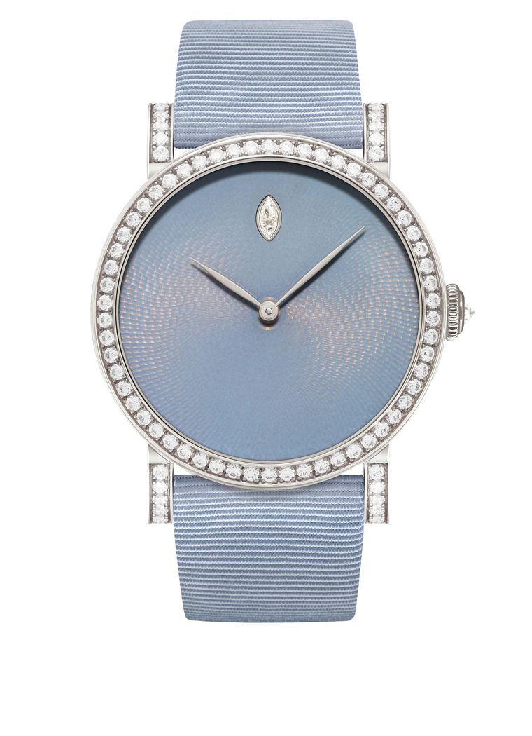 The DeLaneau Rondo Translucent Hoar Frost watch has a 36mm white gold case set alight with 272 diamonds encircling the bezel and lugs. The mysterious greyish-blue enamel dial is punctuated by a single diamond drop marking the hour at 12 o'clock.