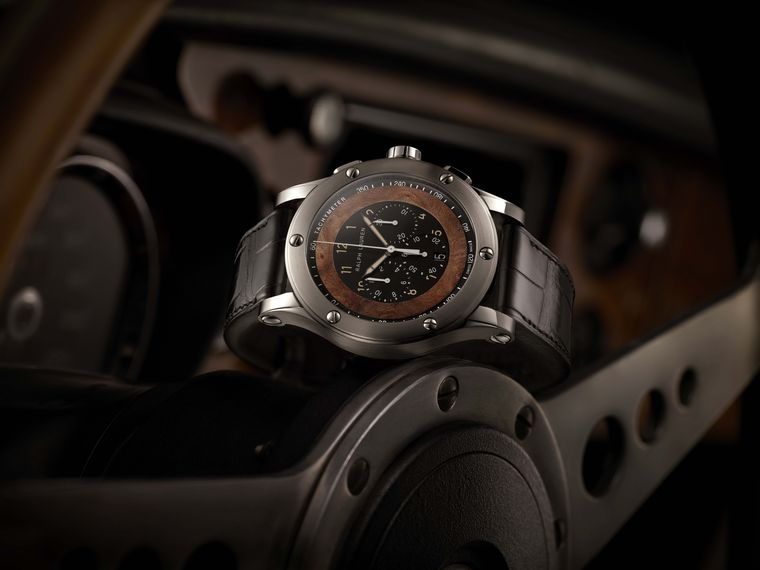 The sleek 45mm steel case of the Ralph Lauren Automotive Chronograph has been polished and brushed to a smooth matte finish and flaunts a sporty touch with the six exposed screws on the bezel. The screws replicate the original ones used on the hub that se