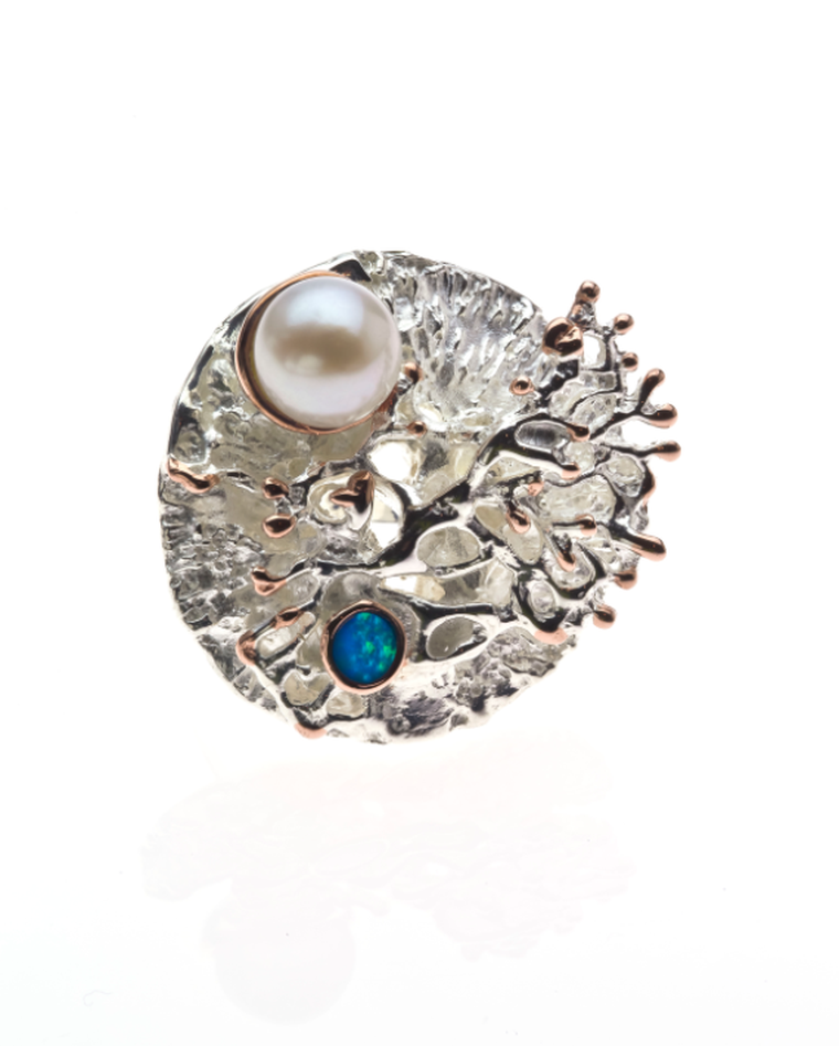 Keiko Uno Coral Garden ring with an opal and freshwater pearl.