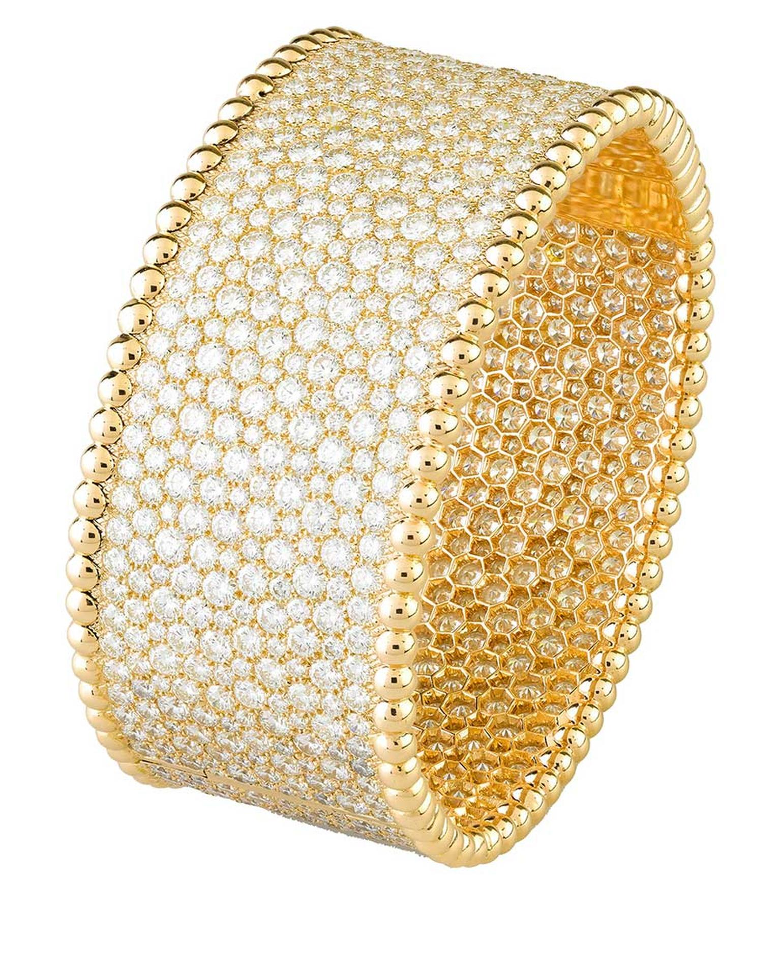 Van Cleef & Arpels Perlée snow-set diamond cuff bracelet showcases the maison's extraordinary craftsmanship by using a technique that makes the jewel appear to have literally been dusted in diamond snowflakes.