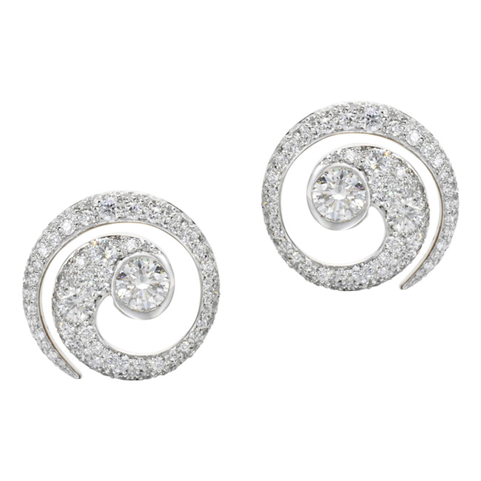 Jessica McCormack Mini Tattoo diamond earrings are inspired by Maori tattoos. At its core is a large, single, round brilliant diamond that leads into a beguiling diamond pavé spiral pattern with a total diamond weight of over 3ct.