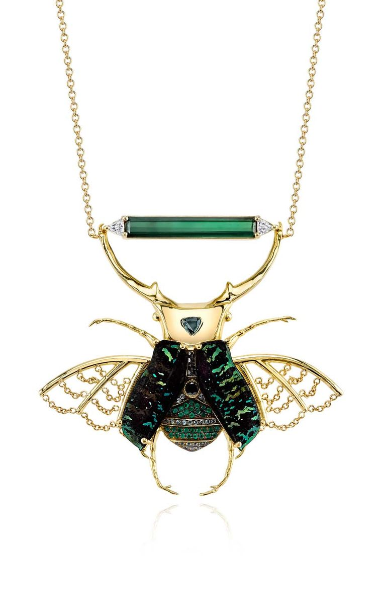Daniela Villegas yellow gold Phoenix necklace with green tourmaline, black and white diamonds, green sapphires, emeralds and euchroea colestis elytras.