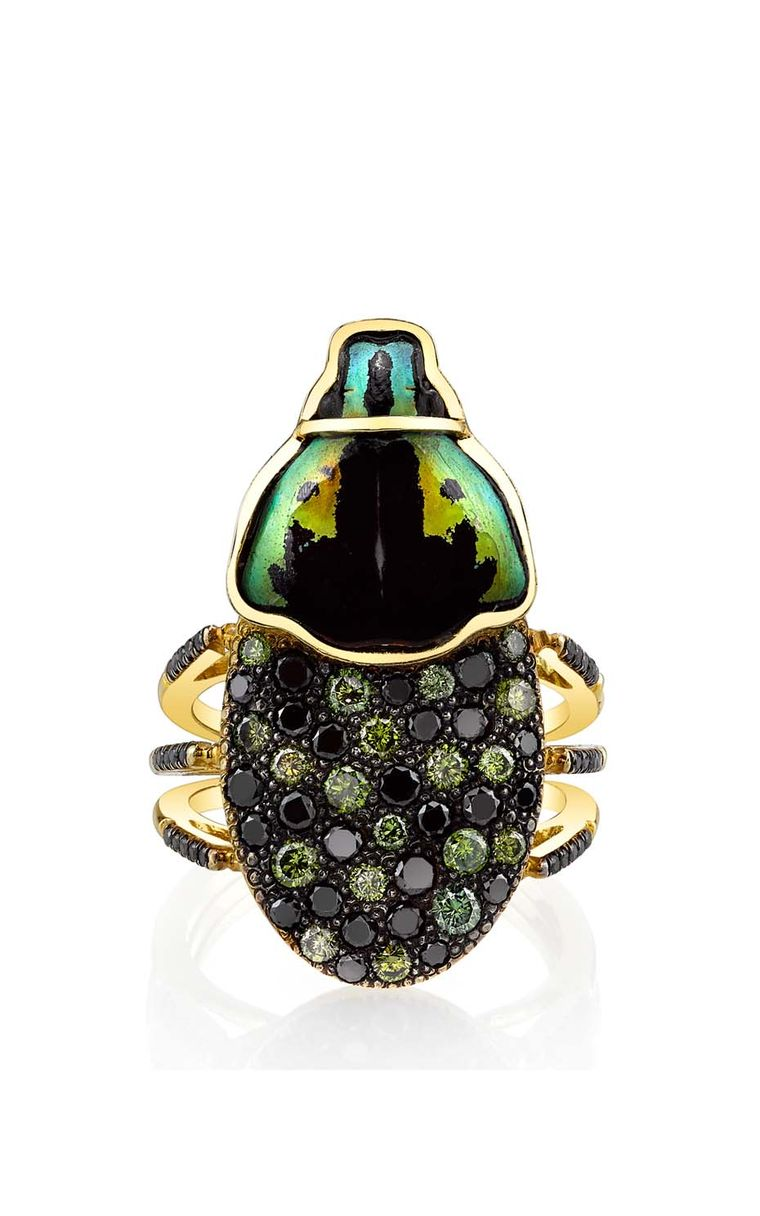 Daniela Villegas yellow and black gold Sybarite ring with green and black diamonds.