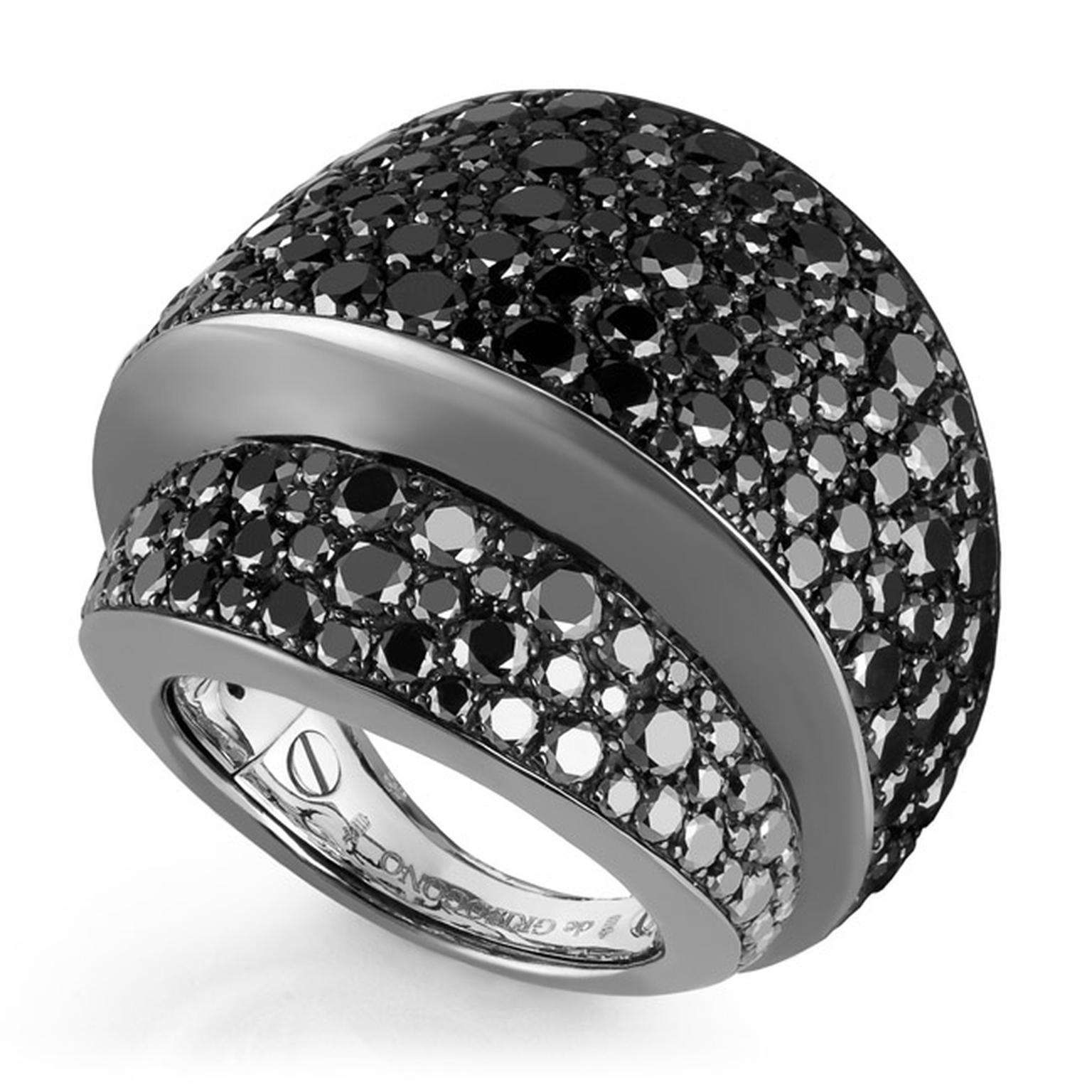 De Grisogono Tubetto diamond ring features smooth curves of black rhodium-plated white gold covered in pavé-set black diamonds.