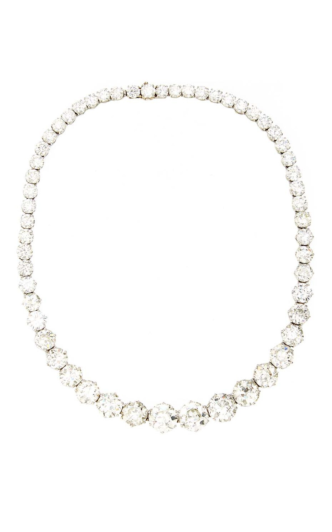 FD Gallery's Bulgari diamond and platinum necklace was commissioned in 1958. Designed rivière-style to appear like a single flowing stream of diamonds about the neck, it was made for Helene Propper de Callejón. $750,000 at Moda Operandi.